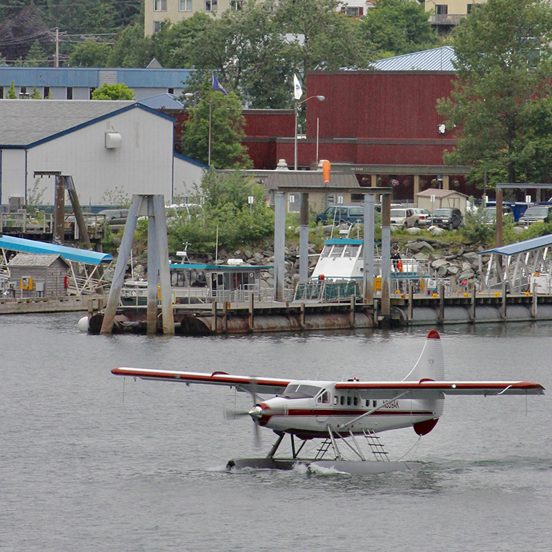 A float plane taking off in Juneau, AK