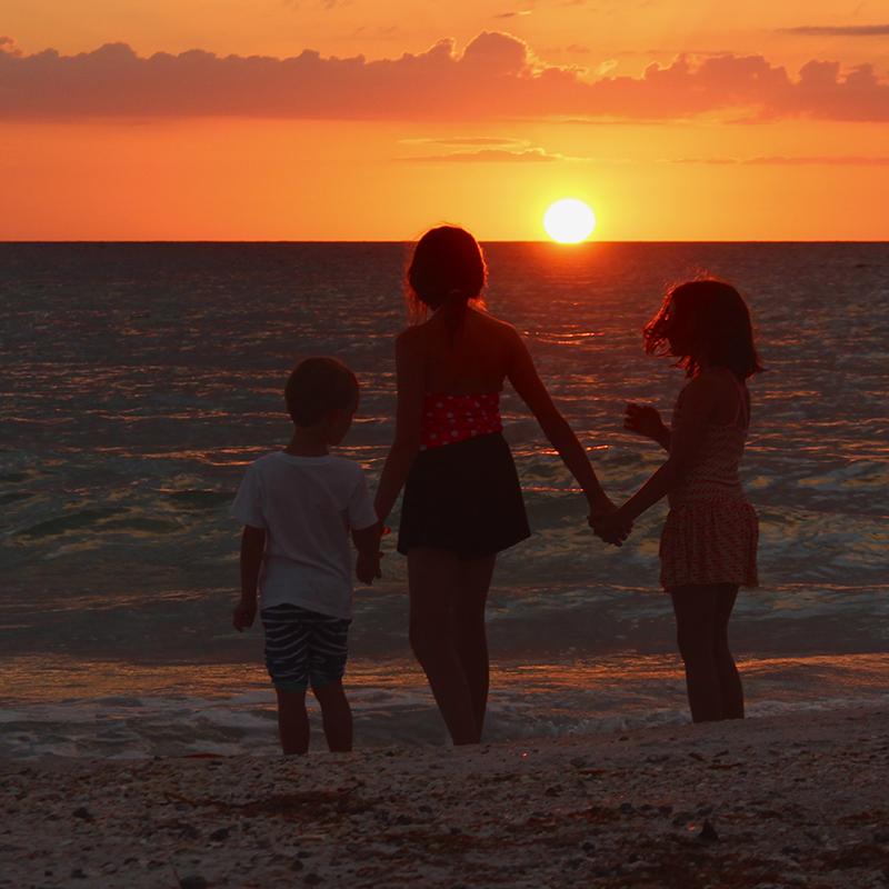 Childhood at sunset on the Gulf of Mexico.