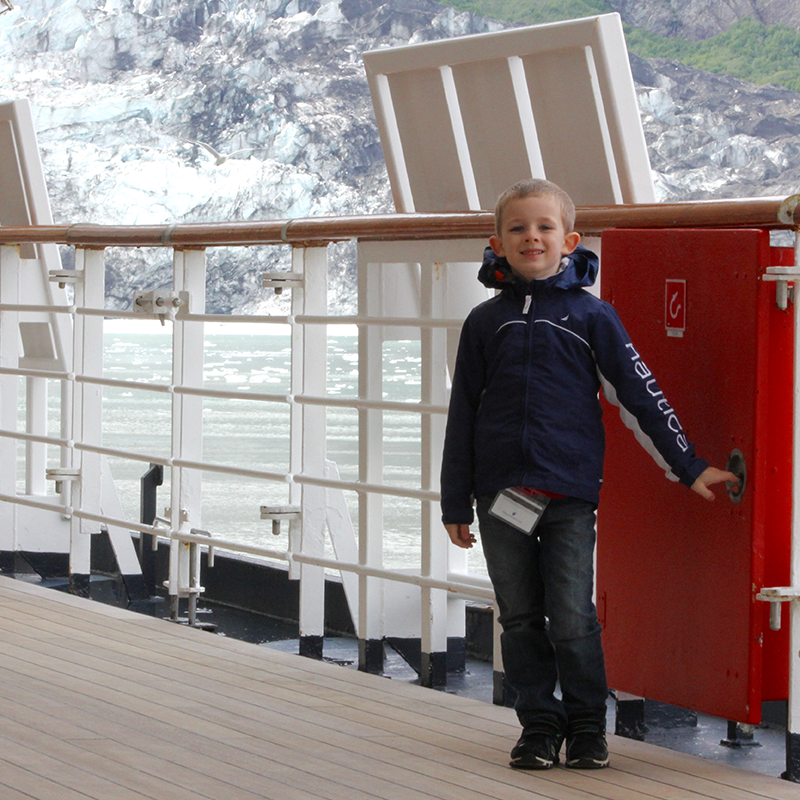 Lesli's son on the deck of a cruise ship in Glacier Bay National Park.