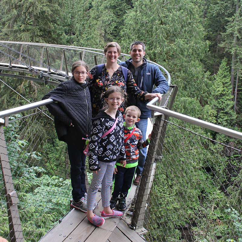 Lesli and her family on the Cliffwalk at the Capilano Suspension Bridge Park in Vancouver, British Columbia.